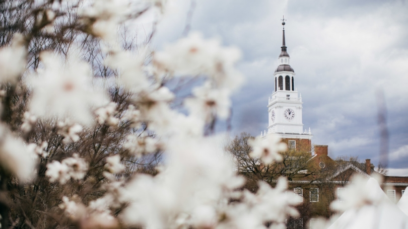 Baker Tower pictured with spring tree blooms.