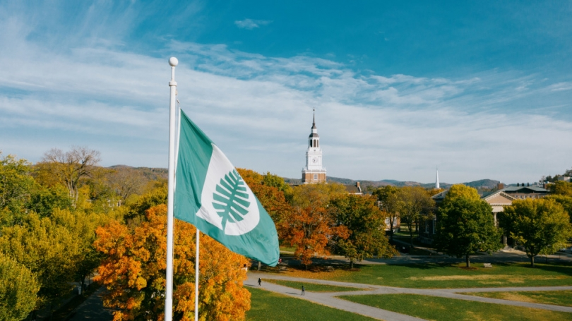 The Dartmouth flag and Baker Tower are seen from above.
