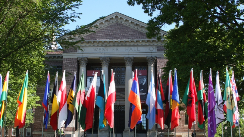 International flags lined up on Dartmouth's campus.