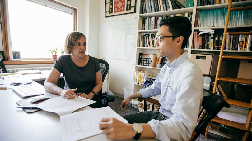 Professor Pavcnik meets with a student in her office.